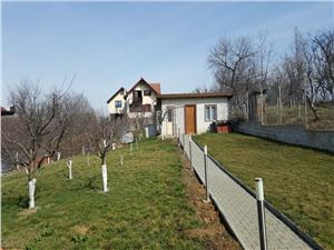 Casa de vanzare in sat de Vacanta